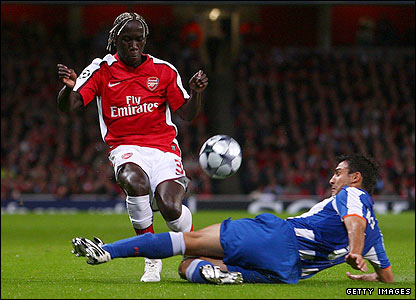 Bacary Sagna is tackled by Porto's Nelson Benitez