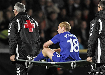 Manchester United's Paul Scholes is stretchered off after injuring his knee