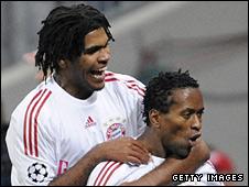 Breno and Ze Roberto celebrate Bayern's equaliser