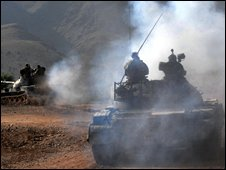 Pakistani Army soldiers patrol on their tanks during a military operation against Islamic militants in Darra Adam Khel on September 29, 2008.