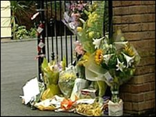 Flower tribute at the gate where Jason Keet died