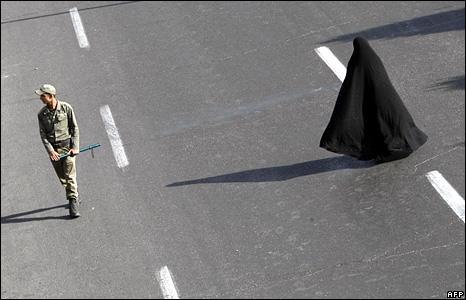An Iranian woman crosses a main road in Tehran after attending an Eid al-Fitr prayer