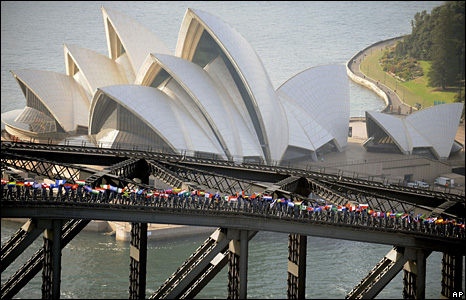 More than 135 climbers fly flags representing the nationalities of people who have scaled the Sydney Harbour Bridge during the 10 years visitors have been able to do so.