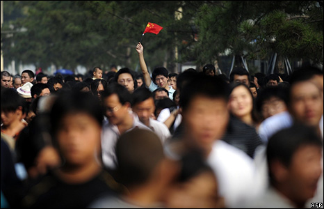 A man waves a Chinese flag during National Day celebrations at Tiananmen Square in the capital, Beijing.