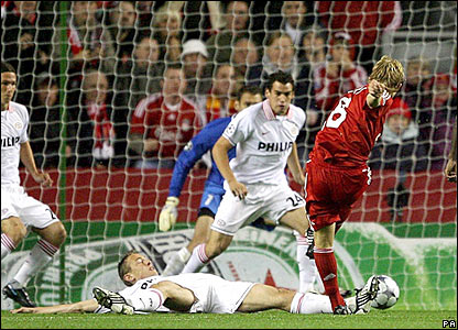 Liverpool's Dirk Kuyt fires home the first goal