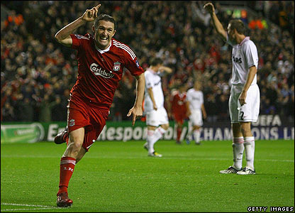 Robbie Keane celebrates scoring his first goal for Liverpool