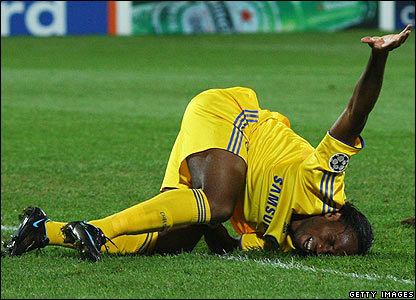 Chelsea's Didier Drogba screams in agony on the pitch