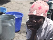 A woman waits at a Unicef water stall in Mabvuku, 16/09