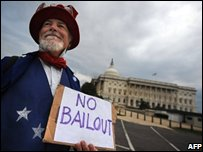 "Miko Sloper of Berkley, California wears an ""Uncle Sam"" costume outside the US Capitol before the senate votes on the rescue bill"
