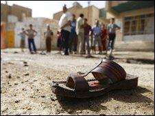A shoe lies on the ground near the site of a suicide bombing in Baghdad's Baghdad al-Jadida neighborhood, in Iraq, 02/10/2008