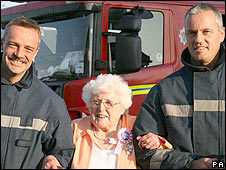 Joan Harries with firefighters