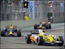 Singapore Grand Prix winner Fernando Alonso leads Mark Webber during the race