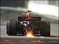 Mark Webber's Red Bull throws up sparks at the Singapore Grand Prix