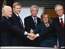 Jack Layton, New Democrats; Prime Minister Stephen Harper, Conservatives; Gilles Duceppe, Bloc Quebecois; Elizabeth May, Green Party; and Liberal leader Stephane Dion pose for photographs before the French language debate