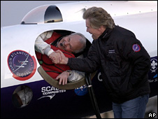Steve Fossett shakes hands with Sir Richard Branson as he prepares to take off in the GlobalFlyer at the Salina Municipal Airport in Salina,Kansas (February 2005)