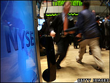 Traders work the floor of the New York Stock Exchange on 2 October