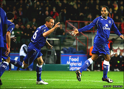 Phil Jagielka, centre, celebrates