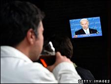 A customer at an Irish pub in San Francisco watches the presidential debate