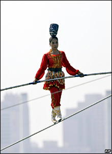 Aixiguli, a Chinese competitor in the World High Wire Championships, balances above the Han River in the South Korean capital, Seoul