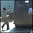 Robber Mark Nunes points a gun at the guard