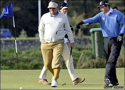 Sir Ian Botham (left) and playing partner David Howell