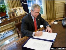U.S. President George W. Bush signs a Wall Street bailout bill in the Oval Office