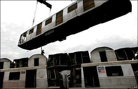 Decommissioned subway cars on a barge in New York