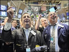New York Stock Exchange traders react as bail-out bill passes