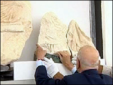 President Napolitano puts the fragment in place.