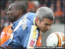 Cardiff's Kevin McNaughton is challenged by Blackpool's Mo Camara