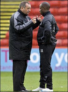 Dons manager Jimmy Calderwood (left) gives directions to midfielder Sone Aluko