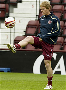 Hearts midfielder Michael Stewart warms up ahead of the match