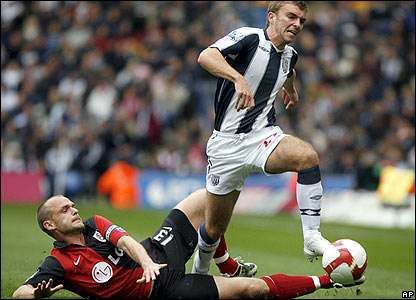 West Brom's James Morrison skips away from Danny Murphy's tackle