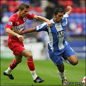 Middlesbrough's Gary O'Neil challenges Amr Zaki