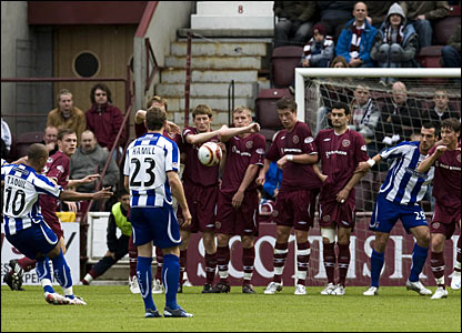 Kilmarnock's Mehdi Taouil (10) curls a delightful ball over the Hearts defence to open the scoring