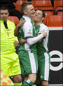 Hibs striker Derek Riordan celebrates his opening goal with team-mate John Rankin