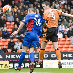 Dundee United take the lead as John Daly (9) rises above Jamie Duff to head the ball home