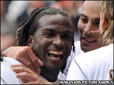 Jason Scotland is congratulated by his Swansea team-mates