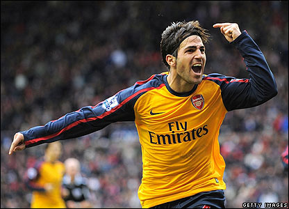 Fabregas celebrates with the travelling fans