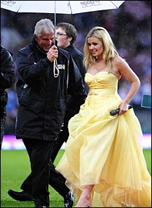 Welsh diva Katherine Jenkins braves the rain to warm up the crowd before kick-off with a rousing rendition of Jerusalem