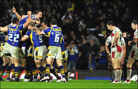 Leeds players, left, celebrate as St Helens look on at Old Trafford