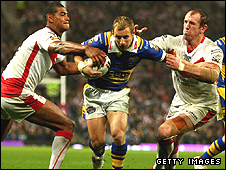 Leon Pryce and Nick Fozzard, right, tackle Rob Burrow