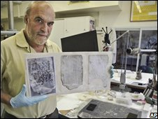 Yigal Zalmona, curator of the Israel Museum, with pages from Ilan Ramon's diary