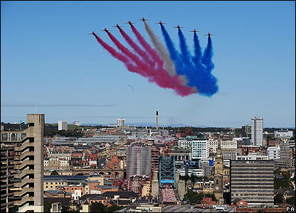 Competitors cross the Tyne Bridge as the Red Arrows fly over during the Great North Run in Newcastle