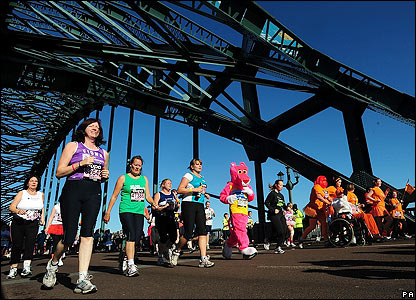 A few remaining runners cross the Tyne Bridge