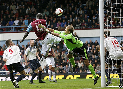 Carlton Cole rises above the Bolton defence to head home in the 69th minute