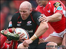 Saracens second row Chris Chesney clatters into the Scarlets defence