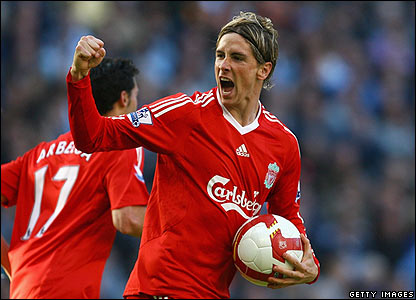 Fernando Torres celebrates after scoring Liverpool's first