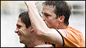 Dundee United's Lee Wilkie celebrates with Jon Daly