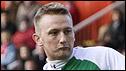 Derek Riordan scores from the spot against Aberdeen